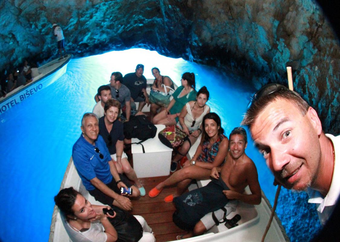 inside blue cave visitors with captain